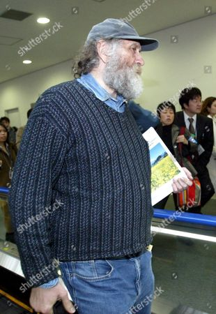 Bobby Fischer Chess Champion Walking Towards the Departure Gate at Tokyo's Narita Airport Thursday 24 March 2005 Fisher Was Held Eight Months by Japanese Immigration Authorities For an Alledged Invalid U S Passport Released After Gaining Natioality by Iceland Fisher is in Route to Iceland Via Copenhagen On Scandinavian Airways Flight
