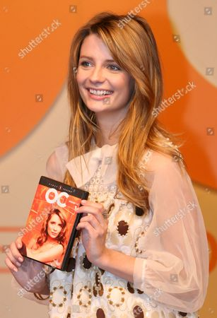 Mischa Barton(l) Actress in Popular Fox Television Series the Oc Holds a Japanese Copy of the Programs Dvd with Japanese Talent Yuri Ebihara at a Press Conference in Tokyo Wednesday 30 January 2007 Barton who Plays the Character Marissa Cooper in the Oc Tv Series is in Tokyo to Promote the Japan Release of the the Oc Dvd Scheduled For March 23rd Japan Tokyo