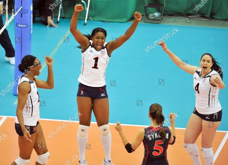 Ogonna Nnamani (1) and Foluke Akinradewo (l) of the United States Celebrates with Teammates Stacy Sykora (5) and Lindsey Berg (4) After Defeating the Netherlands in the Second Round Match at the Women Volleyball World Championships in Nagoya Central Japan 09 November 2010 the United States Won 3-0 Japan Nagoya
