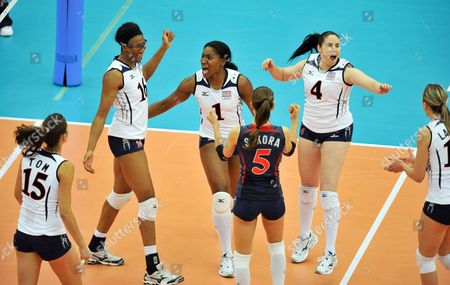 Ogonna Nnamani (1) and Foluke Akinradewo (l) of the United States Celebrates with Teammates Stacy Sykora (5) Lindsey Berg (4) Logan Tom (15) and Jordan Larson (r) After Defeating the Netherlands in the Second Round Match at the Women Volleyball World Championships in Nagoya Central Japan 09 November 2010 the United States Won 3-0 Japan Nagoya
