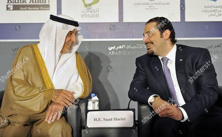 Saudi Prince Khaled Al-faisal Bin Abdul Aziz Al-saud Governor of Mecca (l) Talks with Lebanese Prime Minister Saad Hariri (r) During the Opening Session of the 18th Arab Economic Forum in Beirut Lebanon 20 May 2010 Lebanon Beirut