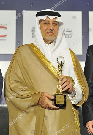 Saudi Prince Khaled Al-faisal Bin Abdul Aziz Al-saud Governor of Mecca Carries His Award During the Opening Session of the 18th Arab Economic Forum in Beirut Lebanon 20 May 2010 the Saudi Prince was Given an Award on His Achivements in Supporting and Funding Several Cultural and Social Projects Throughout the Arab World Lebanon Beirut
