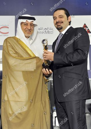 Lebanese Prime Minister Saad Hariri (r) Hands out an Award Saudi Prince Khaled Al-faisal Bin Abdul Aziz Al-saud Governor of Mecca (l) During the Opening Session of the 18th Arab Economic Forum in Beirut Lebanon 20 May 2010 the Saudi Prince was Given an Award on His Achivements in Supporting and Funding Several Cultural and Social Projects Throughout the Arab World Lebanon Beirut