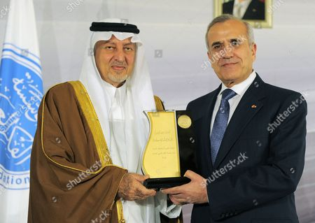 Lebanese President Michel Suleiman (r) Receives an Award From Saudi Arabia's Prince Khaled Al-faisal Bin Abdul Aziz Al-saud (l) Governor of Mecca and Chairman of the Arab Thought Foundation (atf) at the Opening Ceremony of the Ninth Annual Conference of the Arab Thought Foundation's Fikr 9 in Beirut Lebanon 08 December 2010 the Arab Thought Foundation is an International Independent and Non-governmental Organization Founded in 2001 with the Objective of Promoting the Interests of the Arab Region the Ninth Annual Conference of the Arab Thought Foundation's Fikr 9 Will Run Until 09 December 2010 Lebanon Beirut