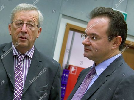 Luxembourg's Prime Minister and Eurogroup President Jean-claude Juncker (l) Looks on Greek Finance Minister Giorgos Papakonstantinou (r) Before the Eurogroup Council Meeting in Luxembourg 18 October 2010 Eu Finance Ministers Held Talks Over Stricter Budget Rules to Avoid Another Government Debt Crisis As Protests Against Spending Cutbacks Rattled France and Italy Luxembourg Luxembourg