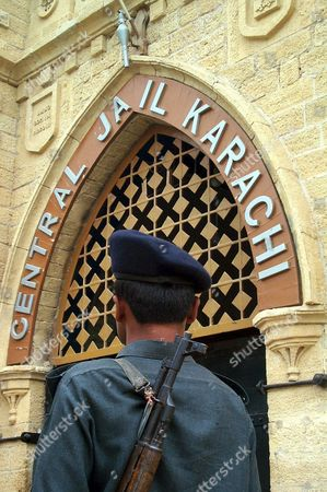 A Pakistani Security Officer Stands Guard in Front of Karachi's Central Jail on Monday 30 June 2003 the Anti-terrorism Court Here Sentenced Asif Zaheer and Rizwan Ahmed Bashir who Allegedly Belong to an Islamic Militant Group Harkat Jehadul Islami to Death on Monday For Organizing a Suicide Bomb Attack That Killed 11 French Naval Technicians in Karachi Last Year the Ruling Came As President Pervez Musharraf is Due to Arrive in France on Wednesday For a Two-day Official Visit Which Will Include Talks with President Jacques Chirac Epa Photo/epa/akhtar Soomro Pakistan Karachi