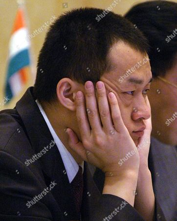 Zhao Liang of China Listens During the 18th Interpol Asian Regional Conference Meeting Held in Manila Tuesday 16 March 2004 an Official Told That the Last Week Bombings in Madrid Showed That Terror Attacks Can Still Occur Any Day and Anywhere in the World Despite Increased Cooperation