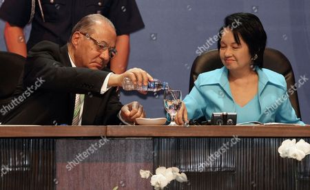 Non-aligned Movement (nam) Chair Dr Mahmoud Hamdy Zakzouk of Egypt (l) Pours Water For Philippine President Gloria Macapagal-arroyo (r) During a Session For the Special Non-aligned Movement Ministerial Meeting (snamm) on Interfaith Dialogue and Cooperation For Peace and Development in Pasay City Suburban Manila Philippines 17 March 2010 Senior Foreign Officials From More Than 100 Member Countries of the Non-aligned Movement (nam) Gathered to Promote Interfaith Dialogue to Help Resolve Conflicts Tensions and Other Social Maladies a Manila Declaration is Expected to Be Forged As a Plan of Action For Cooperation Among Participating Countries Philippines Pasay