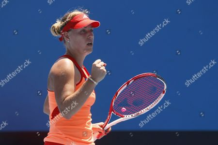 Angelique Kerber of Germany Reacts After Winning a Point During the Second Round Women's Singles Match Against Stephanie Dubois of Canada During the Australian Open Grand Slam Tennis Tournament in Melbourne Australia 19 January 2012 Australia Melbourne
