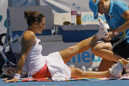 Stephanie Dubois of Canada Receives a Treatment During the Second Round Women's Singles Match Against Angelique Kerber of Germany During the Australian Open Grand Slam Tennis Tournament in Melbourne Australia 19 January 2012 Australia Melbourne