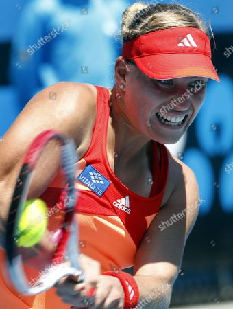 Angelique Kerber of Germany Returns to Stephanie Dubois of Canada in Their Second Round Match at the Australian Open Grand Slam Tennis Tournament in Melbourne Australia on 19 January 2012 Australia Melbourne