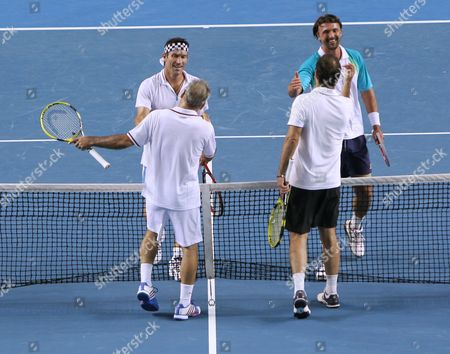 Pat Cash (back L) of Australia and Goran Ivanisevic (back R) of Croatia Shake Hands with Mansour Bahrami (front L) of Iran and Cedric Pioline of France After Their Legends' Doubles Match at the Australian Open Grand Slam Tennis Tournament in Melbourne Australia 21 January 2012 Australia Melbourne