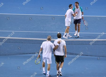 Pat Cash (back L) of Australia and Goran Ivanisevic (back R) of Croatia Shake Hands with Each in Their Legends' Doubles Match Against Mansour Bahrami (front L) of Iran and Cedric Pioline of France at the Australian Open Grand Slam Tennis Tournament in Melbourne Australia 21 January 2012 Australia Melbourne