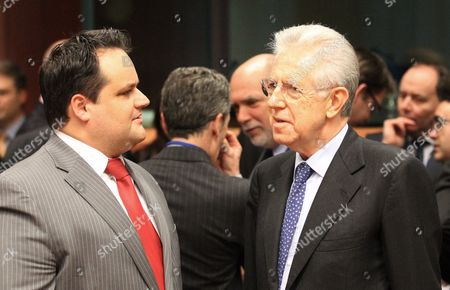 Italian Prime Minister Mario Monti (r) Chats with Dutch Finance Minister Jan Kees De Jager at the Start of a Euro Group Finance Ministers Council at the Eu Headquarters in Brussels Belgium 12 March 2012 Europe's Economic Crisis was Back in the Limelight at a Meeting of Eurozone Finance Ministers on Monday Evening with Perennial Problem Child Greece and Fresh Worries About Spain's Deficit on the Agenda Athens is Waiting For the Ministers to Give a Green Light to Its Second 130-billion-euro (171-billion-dollar) Bailout Which It Needs by March 20 to Avoid Going Bankrupt Belgium Brussels