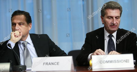 European Commissioner For Energy German Guenther Oettinger (r) and French Energy Minister Eric Besson (l) at the Start of Eu Energy Minister Meeting in Brussels Belgium 24 November 2011 Belgium Brussels