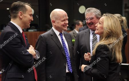 (l-r) Polish Foreign Ministers Radoslaw Sikorski British Foreign Secretary William Hague Luxembourg's Foreign Minister Jean Asselborn and Spanish Foreign Minister Trinidad Jimenez Chat at the Start of a Eu Foreign Affairs Council in Brussels Belgium 01 December 2011 Belgium Brussels
