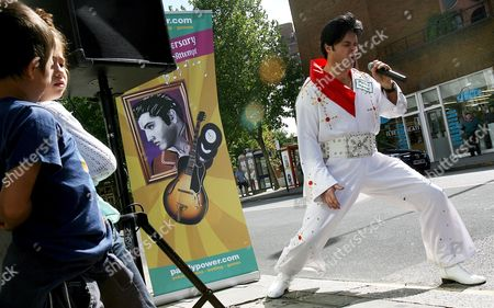 Elvis Impersonator Andy Woodward Performs in Downtown London 16 August 2007 Woodward is Attempting to Set a New World Record August 16 to Perform Thirty Live Elvis Tribute Performances by One Person in One Day August 16 is the 30th Anniversary Since Elvis' Death United Kingdom London