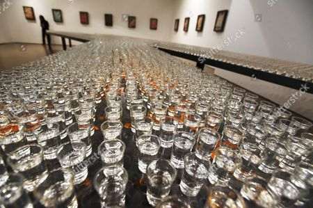 A View of an Art Installation Composed of 4 600 Shot Glasses Filled with Erguotou a Chinese Grain Alcohol by Greek Artist Jannis Kounellis As Part of an Exhibition Titled 'Translating China' in Today Art Museum in Beijing China 25 November 2011 a Master of the Arte Povera Movement Kounellis Uses Everyday Materials Like Porcelain Pieces Coal Steel Plates Copper Plates Clothes and Utensils to Create Works That Express His Thoughts on Chinese Society and Culture in His First Solo Exhibition in the Country the Exhibition Runs Till 13 December China Beijing