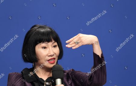 Chinese-american Writer Amy Tan Gestures During a Panel Discussion Titled 'Growing Up in Two Worlds' at the Us-china Forum on the Arts and Culture at the National Centre For the Performing Arts in Beijing China 17 November 2011 the First Ever Us-china Forum on the Arts and Culture Opens on 17 November where a Host of American Cultural Luminaries in the Visual and Performing Arts Music Literature and Cuisine Will Meet with Their Chinese Counterparts and Audiences During the Four-day Forum to Converse and Share Insights in Their Particular Fields China Beijing