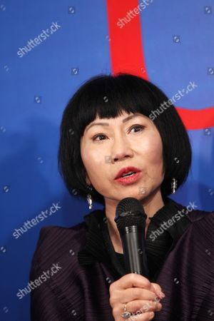 Chinese-american Writer Amy Tan Speaks to Reporters During a Press Conference of the Us-china Forum on the Arts and Culture at the National Centre For the Performing Arts in Beijing China 17 November 2011 the First Ever Us-china Forum on the Arts and Culture Opens on 17 November where a Host of American Cultural Luminaries in the Visual and Performing Arts Music Literature and Cuisine Will Meet with Their Chinese Counterparts and Audiences During the Four-day Forum to Converse and Share Insights in Their Particular Fields China Beijing
