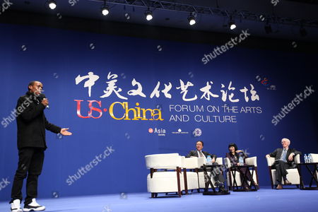 Us Street Dancer and Choreographer Charles 'Lil Buck' Riley (l) Gives an Introduction For Cellist Yo-yo Ma (3-r) and Writer Amy Tan (2-r) While Orville Schelle (r) Arthur Ross Director of Us China Relations at the Asia Society in New York Looks on During a Panel Discussion at the Us-china Forum on the Arts and Culture at the National Centre For the Performing Arts in Beijing China 17 November 2011 the First Ever Us-china Forum on the Arts and Culture Opens on 17 November where a Host of American Cultural Luminaries in the Visual and Performing Arts Music Literature and Cuisine Will Meet with Their Chinese Counterparts and Audiences During the Four-day Forum to Converse and Share Insights in Their Particular Fields China Beijing