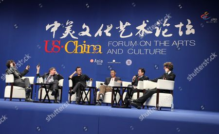 Us Director Joel Coen (l) and Producer David Fanning (2-l) Hold Up Their Translation Transmitters For Better Transmission During a Panel Discussion with (3-l-r) Chinese Directors Lu Chuan He Ping President Assistant of the Chinese National Academy of Arts Jia Leilei and Us Producer and Former Dancer Damian Woetzel at the Us-china Forum on the Arts and Culture at the National Centre For the Performing Arts in Beijing China 17 November 2011 the First Ever Us-china Forum on the Arts and Culture Opens on 17 November where a Host of American Cultural Luminaries in the Visual and Performing Arts Music Literature and Cuisine Will Meet with Their Chinese Counterparts and Audiences During the Four-day Forum to Converse and Share Insights in Their Particular Fields China Beijing