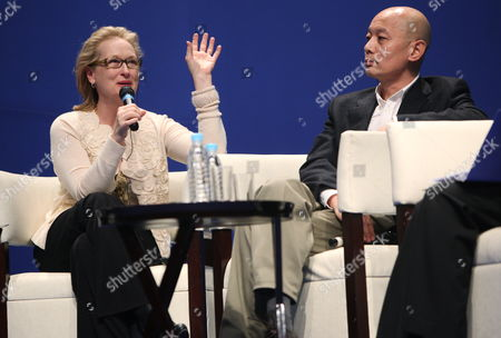 Us Actress Meryl Streep (l) Speaks As Chinese Actor Ge You Looks on at a Panel Discussion Titled 'On Film and Performing: the Actors Perspective' During the Us-china Forum on the Arts and Culture at the National Centre For the Performing Arts in Beijing China 18 November 2011 Us Celebrities in the Visual and Performing Arts Music Literature and Cuisine Meet with Their Chinese Counterparts and Audiences During the Four-day Forum to Converse and Share Insights in Their Particular Fields China Beijing