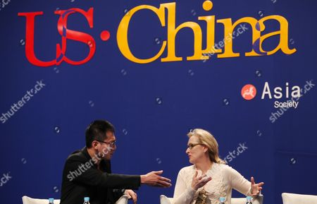 Us Actress Meryl Streep (r) and Chinese Actor Liu Ye Gestures at a Panel Discussion Titled 'On Film and Performing: the Actors Perspective' During the Us-china Forum on the Arts and Culture at the National Centre For the Performing Arts in Beijing China 18 November 2011 Us Celebrities in the Visual and Performing Arts Music Literature and Cuisine Meet with Their Chinese Counterparts and Audiences During the Four-day Forum to Converse and Share Insights in Their Particular Fields China Beijing