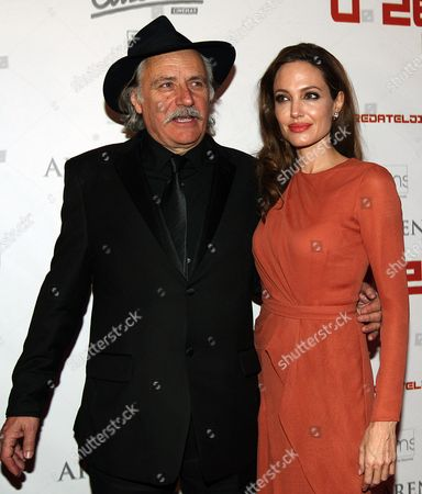 Us Actress/director Angelina Jolie (l) and Serbian-born Croatian Actor Rade Serbedzija (l) Pose Before the Croatian Premiere of 'In the Land of Blood and Honey' at the Cinestar Movie Hall in Zagreb Croatia 17 February 2012 Jolie Arrived in Zagreb to Present Her Directorial Debut in the Land of Blood and Honey a Bosnian War Drama Croatia Zagreb