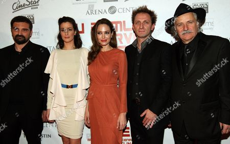 Us Actress/director Angelina Jolie (c) Poses with Cast Members Zana Marjanovic (2-l) Goran Kostic (2-r) and Rade Serbedzija (r) Before the Croatian Premiere of Her Movie 'In the Land of Blood and Honey' at the Cinestar Movie Hall in Zagreb Croatia 17 February 2012 Jolie Arrived in Zagreb to Present Her Directorial Debut in the Land of Blood and Honey a Bosnian War Drama Croatia Zagreb