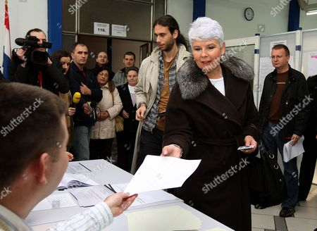 Croatian Prime Minister and President of Late the Croatian Democratic Union (hdz) Jadranka Kosor (2-r) Casts Her Vote in the Croatian Elections at a Polling Polling Station in Zagreb 04 December 2011 Seen in Background is Her Son Lovro Voters in Croatia Went to the Polls 04 December to Elect the Parliament and Government That Will Lead the Country to European Union Membership in July 2013 Prime Minister Jadranka Kosor's Conservative Croatian Democratic Union (hdz) Has Been Plagued by Corruption Scandals and is Expected to Lose to the Opposition Social Democratic Party Despite Driving the Country to the Eu Doorstep Croatia Zagreb