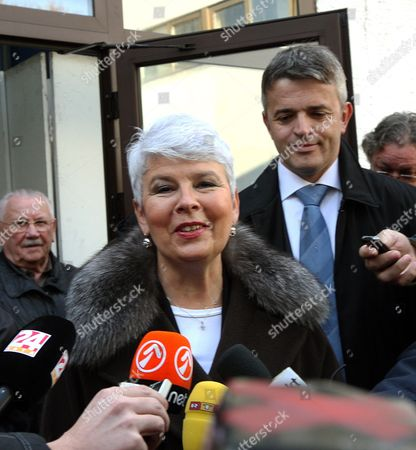 Croatian Prime Minister and President of Late the Croatian Democratic Union (hdz) Jadranka Kosor (c) Speaks to Journalists After Casting Her Vote in the Croatian Elections at a Polling Polling Station in Zagreb 04 December 2011 Voters in Croatia Went to the Polls 04 December to Elect the Parliament and Government That Will Lead the Country to European Union Membership in July 2013 Prime Minister Jadranka Kosor's Conservative Croatian Democratic Union (hdz) Has Been Plagued by Corruption Scandals and is Expected to Lose to the Opposition Social Democratic Party Despite Driving the Country to the Eu Doorstep Croatia Zagreb