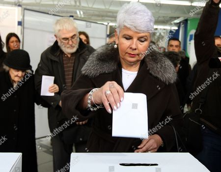 Croatian Prime Minister and President of Late the Croatian Democratic Union (hdz) Jadranka Kosor (c) Casts Her Vote in the Croatian Elections at a Polling Polling Station in Zagreb 04 December 2011 Voters in Croatia Went to the Polls 04 December to Elect the Parliament and Government That Will Lead the Country to European Union Membership in July 2013 Prime Minister Jadranka Kosor's Conservative Croatian Democratic Union (hdz) Has Been Plagued by Corruption Scandals and is Expected to Lose to the Opposition Social Democratic Party Despite Driving the Country to the Eu Doorstep Croatia Zagreb
