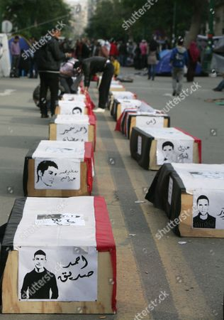 The Mock Coffins of Egyptians who Died in Clashes with Security Forces Earlier in the Month Are Placed in the Egyptian Parliament and Prime Minister Office Street As Some Protesters Continue Their Sit-i in That Street and in Tahrir Square One Day Before the Run-off in the First Round of the Parliamentary Elections Cairo Egypt 04 December 2011 According to Media Reports the Decision on the New Egyptian Cabinet was Delayed Again on 03 December After Prime Minister-designate Kamal Al-ganzouri Said He Would Reconsider Some of the Nominations Many Activists Have Rejected Al-ganzouri Because of His Ties to the Mubarak Regime He Served As Prime Minister From 1996-1999 the Interim Ruling Supreme Council of the Armed Forces Appointed Al-ganzouri to Replace Outgoing Premier Essam Sharaf who Resigned After After 42 People Were Killed in Countrywide Clashes Between Protesters and Police in November the Clashes Were the Worst Since the January 25 Revolution Which Led to the Fall of Mubarak Egypt Has Seen Renewed Protests with Activists Pushing For the Military to Speed Up the Transfer of Power to a Civilian Government Egypt Cairo
