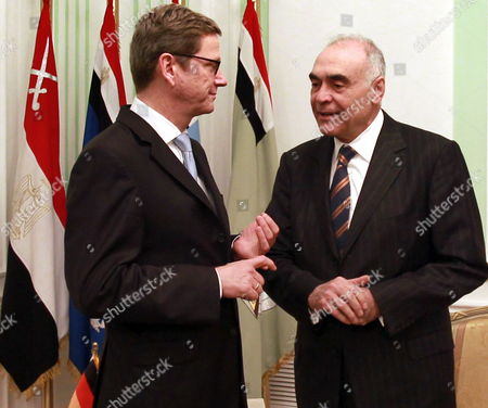 German Foreign Minister Guido Westerwelle (l) Speaks with His Egyptian Counterpart Mohamed Kamel Amr Before His Meeting with Egyptian Field Marshal Mohamed Hussein Tantawi (not Pictured) in Cairo Egypt 31 January 2012 Westerwelle is on a Four-nation Regional Tour Egypt Cairo