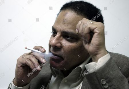 Egyptian Novelist Alaa Al-aswany is Seen During an Interview with a Journalist From Spanish News Agency Efe at His Office in Cairo Egypt 09 December 2011 Egyptian Novelist Alaa Al-aswany During an Interview with a Journalist From Spanish News Agency Efe at His Office in Cairo Egypt 09 December 2011 According to Media Reports End November Al-aswany was Named One of the Top Global Thinkers by the Foreign Policy Magazine in Its Annual List of 100 Men and Women who Influence the World Egypt Cairo