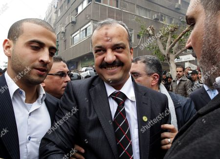 Stock Photo of Member of the Parliament and Member of the Muslim Brotherhood Mohamed El-baltagy (c) Smiles As He Arrives to Attend the First Session of the Newly Elected Parliament in Cairo Egypt 23 January 2012 Egypt's Newly-elected Parliament Held Its Inaugural Session on 23 January with Islamists Dominating the First Assembly Since the Overthrow of President Hosni Mubarak Last Year the Muslim Brotherhood Group Which Won 47 Per Cent of the Seats Has Nominated Mohammed Saad Al-katatny a Senior Official in Its Party to the Post of Parliament Speaker Egypt Cairo