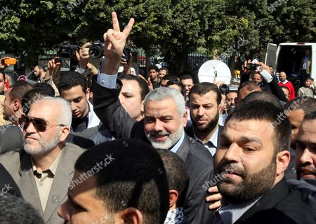 Hamas Leader Ismail Haniyeh (c) Flashes the Victory Sign As He Arrives to Perform the Friday Noon Prayer at Al-azhar Mosque in Cairo Egypt 24 February 2012 According to Media Reports Haniyeh Joined Hundreds of Egyptians Gathering at Al-azhar Mosque on 24 February to Show Solidarity with the Palestinians Against Israeli Settlers' Attacks on Al-aqsa Mosque the Gathering Also Aimed at Showing Support to the Syrian People Egypt Cairo