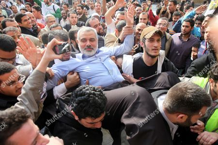 Hamas Leader Ismail Haniyeh (c) is Carried by Supporters Following Friday Noon Prayer at Al-azhar Mosque in Cairo Egypt 24 February 2012 According to Media Reports Haniyeh Joined Hundreds of Egyptians Gathering at Al-azhar Mosque on 24 February to Show Solidarity with the Palestinians Against Israeli Settlers' Attacks on Al-aqsa Mosque the Gathering Also Aimed at Showing Support to the Syrian People Egypt Cairo