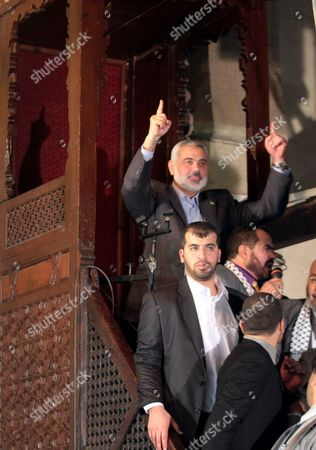 Hamas Leader Ismail Haniyeh (top) Gestures While Addressing Muslim Worshippers Following Friday Noon Prayer at Al-azhar Mosque in Cairo Egypt 24 February 2012 According to Media Reports the Leaders of the Palestinian Movements Hamas and Fatah Are in Egypt For Talks on a Palestinian Reconciliation Deal an Agreement was Sealed in Qatar Earlier This Month Stating That Current President Mahmoud Abbas Will Serve As Prime Minister of an Interim Unity Government Between the Rival Groups Egypt Cairo