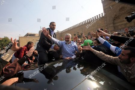 Hamas Leader Ismail Haniyeh (c) Greets Supporters As He Leaves Following Friday Noon Prayer at Al-azhar Mosque in Cairo Egypt 24 February 2012 According to Media Reports Haniyeh Joined Hundreds of Egyptians Gathering at Al-azhar Mosque on 24 February to Show Solidarity with the Palestinians Against Israeli Settlers' Attacks on Al-aqsa Mosque the Gathering Also Aimed at Showing Support to the Syrian People Egypt Cairo