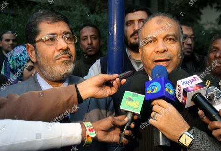 Leaders of the Muslim Brotherhood's Freedom and Justice Party President Mohammed Morsi (l) and Secretary General Saad Al-katatni (r) Address a Press Conference Outside a Polling Station During the Second Round of Parliamentary Elections in Giza Egypt 14 December 2011 Reports Stated That Egyptians Turned out in Large Numbers at Polling Stations in Nine Governorates on 14 December For the Second Round of Parliamentary Elections in Which the Islamists Were Expected to Take the Lead in the Initial Round of the Elections the Muslim Brotherhood's Freedom and Justice Party Won 46 Per Cent of the Vote Followed by the Hardline Salafist Al-nour with 25 Per Cent Egypt Giza