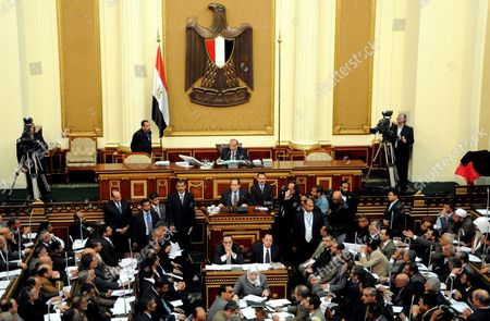 Egyptian Parliament Speaker Saad Al-katatni (c-top) Presides Over a Session Attended For the First Time Since the Assembly's Election by Prime Minister Kamal Al-ganzouri (c) in Cairo Egypt 31 January 2012 the Parliament Had Convened For the First Time Since Its Election on 23 November the Muslim Brotherhood's Freedom and Justice Party (fjp) Won the Majority of the Seats Egypt Cairo