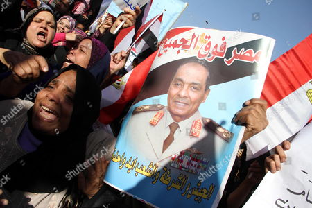 Egyptians Hold Photo of Field Marshal Mohamed Hussein Tantawi Head of the Ruling Supreme Council of the Armed Forces (scaf) During a Protest at Abassiya Square Cairo Egypt 23 December 2011 Hundreds of Scaf Supporters Gathered to Show Support For the Ruling Military Council Few Kilometer From Protesters in Tahrir Square Central Cairo who Are Protesting Against the Ruling Military's Use of Violence Against Women Recent Clashes That Started on 16 December Near the Cabinet Headquarters Had Left 17 People Dead and Hundreds Injured Egypt Cairo