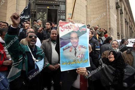 Supporters of the Egyptian Armed Forces Shout Slogans and Hold a Placard Depicting Head of the Military Council Field Marshal Mohamed Hussein Tantawi During Protest in Cairo Egypt 21 February 2012 According to Media Report on 19 February Mahmoud Atteyah Founder of a Campaign Supporting the Head of the Ruling Supreme Council of the Armed Forces (scaf) Tantawi For Presidency Demanded Legal Measures to Be Taken Against a Member of Parliament Ziad Al-elaimy who Criticized the Head of the Military Council During a Visit in Port Said Egypt Cairo