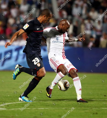 Zamalek Shikabala (r) Fights For the Ball with Atletico Madrid's Miranda (l) During a Friendly Match Atletico Madrid Against Egyptian Team Zamalek to Celebrate Its 100th Anniversary in Cairo Egypt 10 November 2011 Egypt Cairo