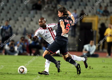 Zamalek Player Shikabala (l) Fight For the Ball with Atletico Madrid's Filipe Luis (r) During the Friendly Match Atletico Madrid Against Egyptian Team Zamalek to Celebrate Its 100th Anniversary in Cairo Egypt 10 November 2011 Egypt Cairo