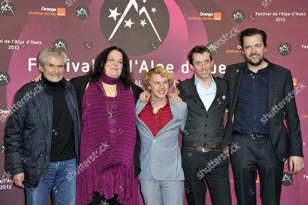 Stock Image of French Director Claude Lelouch Belgian Actors (l to R) Elisabeth De Hertogh Gilles De Schryver Tom Audenaert and Belgian Director Geoffrey Enthoven Pose at the Photocall of 'Hasta La Vista' During the 15th Annual International Comedy Film Festival in L'alpe D'huez France 18 January 2012 the Festival Runs From 17 to 22 January France Alpe D'huez
