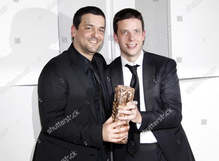 French Director Joann Sfar (l) and Antoine Delesvaux (r) Pose with the Best Animated Feature Film For 'Le Chat Du Rabbin' During the 37th Annual Cesar Awards Ceremony Held at the Chatelet Theatre in Paris France 24 February 2012 France Paris
