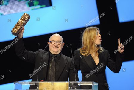 French Actor Michel Blanc (l) Celebrates After Receiving the Cesar Award For Best Actor in a Supporting Role in 'L'exercice De L'etat' From French Actress Mathilde Seigner (r) During the 37th Annual Cesar Awards Ceremony Held at the Chatelet Theatre in Paris France 24 February 2012 France Paris